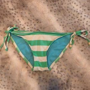 Green and white striped bathing suit bottoms